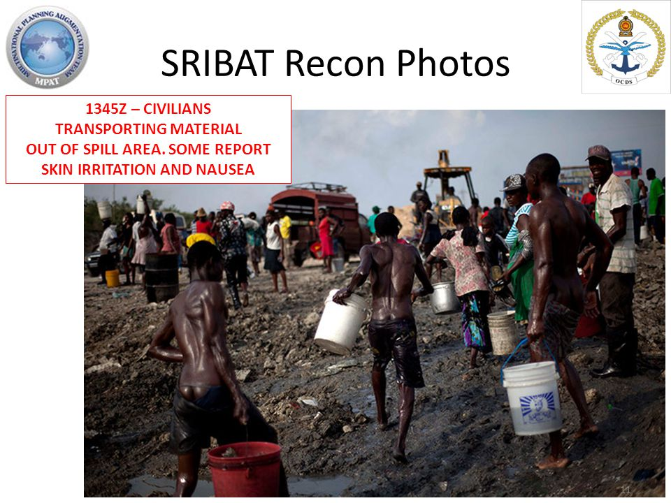 SRIBAT Recon Photos 1345Z – CIVILIANS TRANSPORTING MATERIAL OUT OF SPILL AREA.