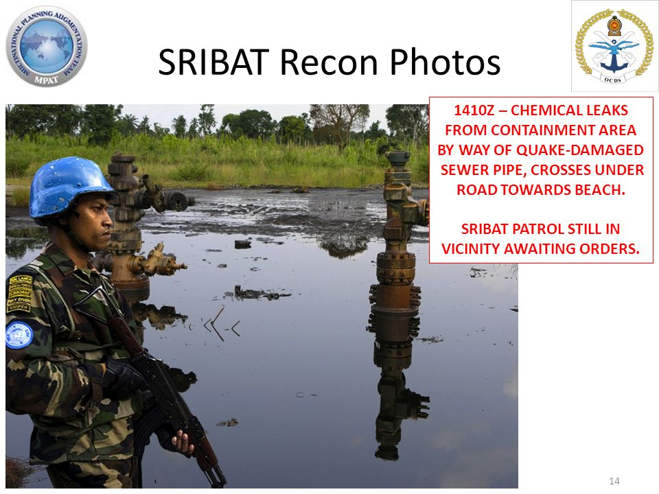 SRIBAT Recon Photos 1410Z – CHEMICAL LEAKS FROM CONTAINMENT AREA BY WAY OF QUAKE-DAMAGED SEWER PIPE, CROSSES UNDER ROAD TOWARDS BEACH.