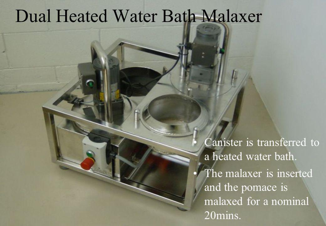 Dual Heated Water Bath Malaxer Canister is transferred to a heated water bath.