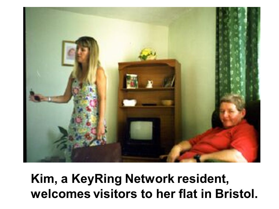 Kim, a KeyRing Network resident, welcomes visitors to her flat in Bristol.