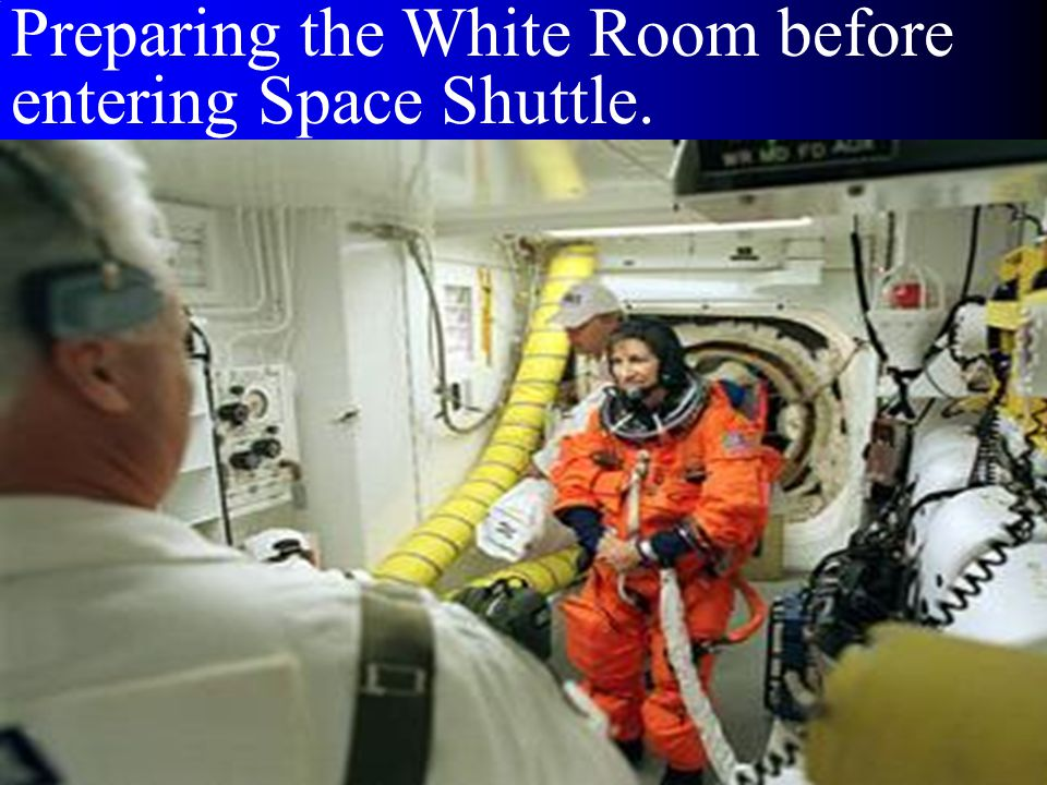 Preparing the White Room before entering Space Shuttle.