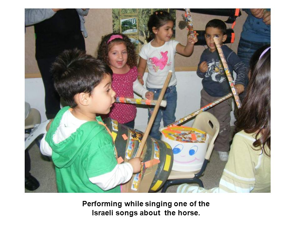 Performing while singing one of the Israeli songs about the horse.