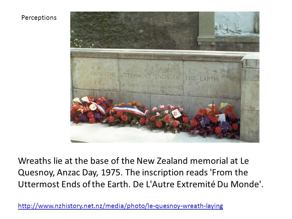 Wreaths lie at the base of the New Zealand memorial at Le Quesnoy, Anzac Day, 1975.