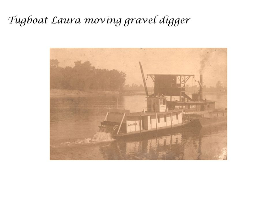 Tugboat Laura moving gravel digger