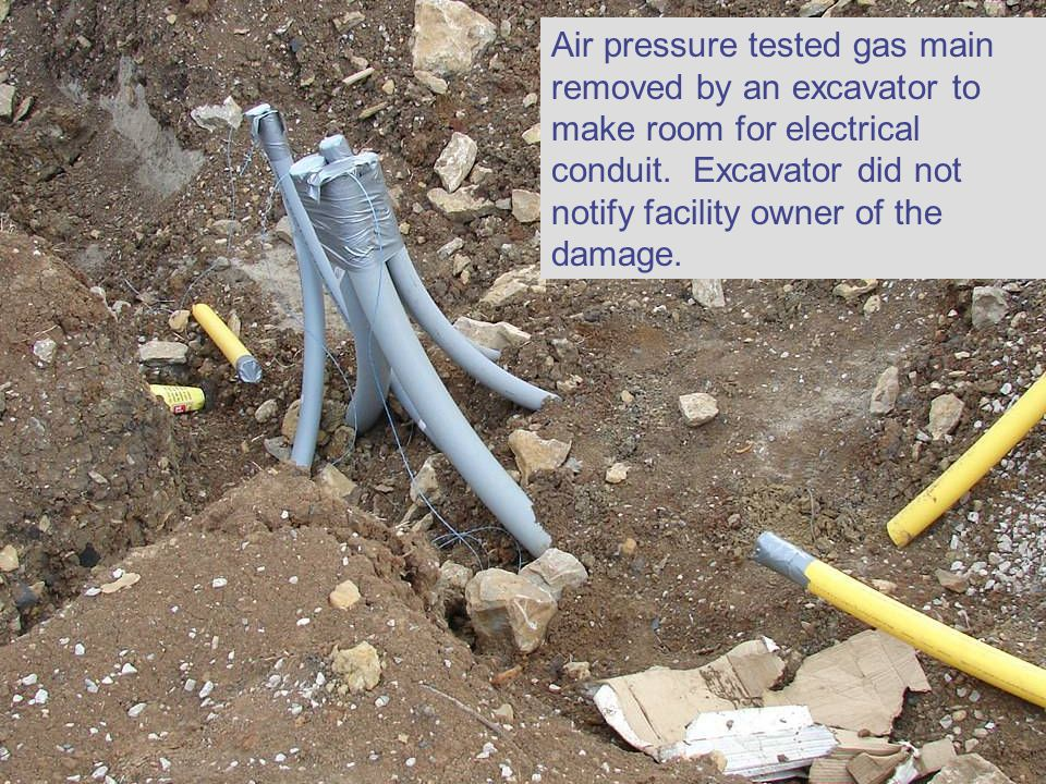 Air pressure tested gas main removed by an excavator to make room for electrical conduit.