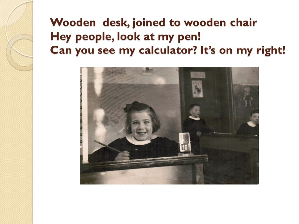 Wooden desk, joined to wooden chair Hey people, look at my pen.