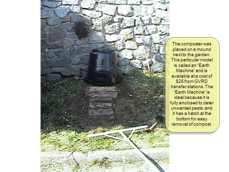 The composter was placed on a mound next to the garden.