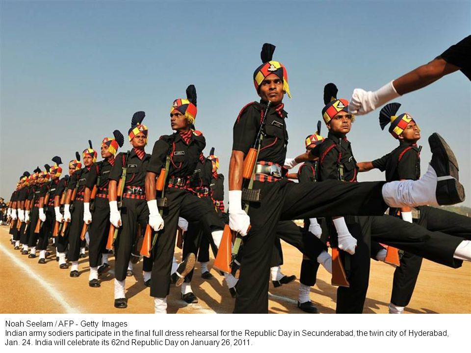 Raminder Pal Singh / EPA Indian students wave tri-colored strips, representing the colors of the Indian national flag as they perform during India s Republic Day celebrations in the northern Indian city of Amritsar, Jan.